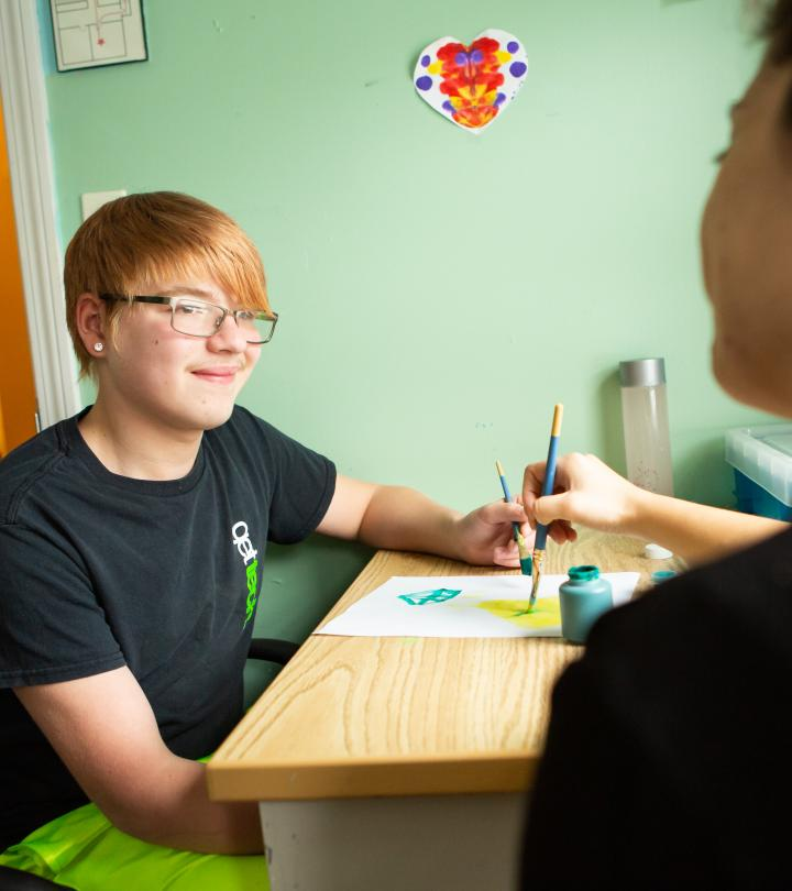 A student smiling at therapist.
