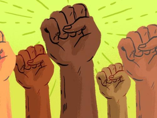 Multiracial fists in the air
